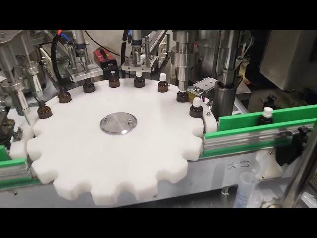 petite machine de remplissage de bouteilles de liquide