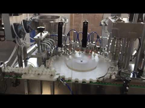machine de capsulage rotative de haute précision des industries alimentaires, des sauces et des cosmétiques