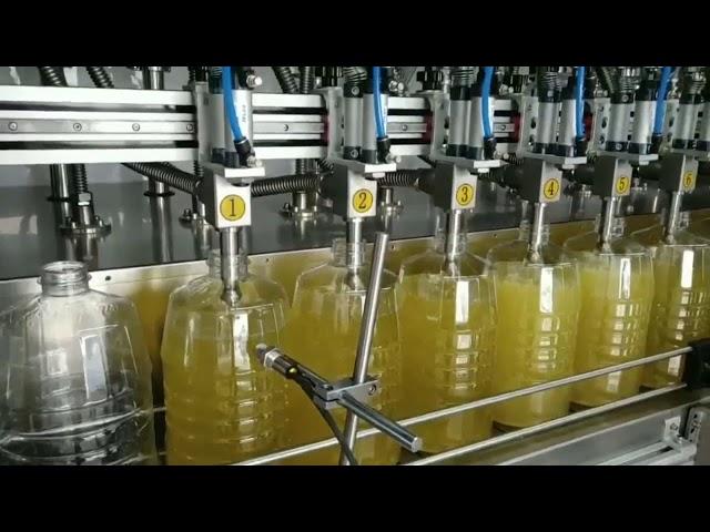 machine de remplissage d'huile de lubrification de pompe péristaltique automatique