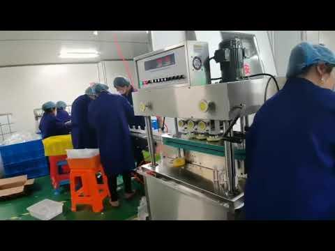 machine de remplissage et de capsulage rotative