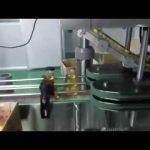 machine de remplissage d'huile de moteur entièrement automatique de type linéaire