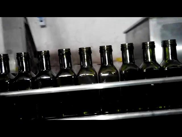 remplisseuse de bouteilles d'huile entièrement automatique à huile d'olive linéaire 6 buses